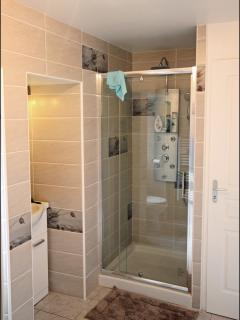 Ensuite shower room to downstairs king bedroom, with massage & rain shower and heated towel rail.