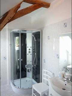Upstairs shower room with rain & massage shower and heated towel rail.