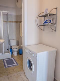 Bathroom, washing machine, iron, hair dryer