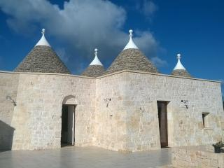 Black Horse - Trulli surrounded by a Vineyard, Locorotondo