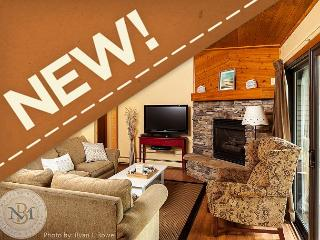 This Beautiful Condominium Sleeps 10 Steps from Whitefish Lake!