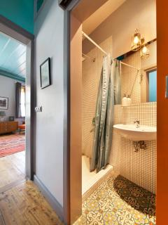 Two bathrooms equipped with powerful rain showers to wake you up for the day.