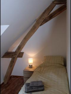 Upstairs twin bedroom showing one of the oak A-frames.