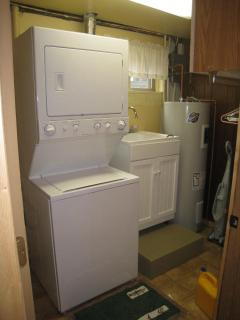 full laundry, ironing board, utility sink, lower level