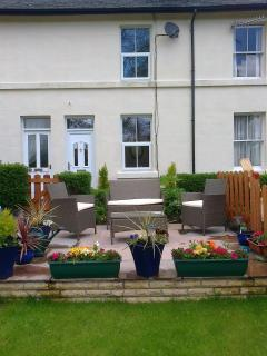 Swan View Cottage has a newly landscaped patio and garden (+ friendly pheasants)