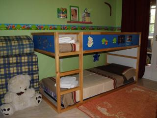 Bedroom with bunks and playroom