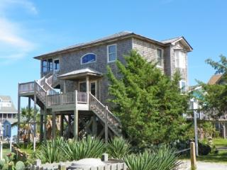 An island jewel, waterfront property with boat docking perfect for a couple or