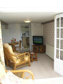 Lounge with bi fold doors which can close off the conservatory
