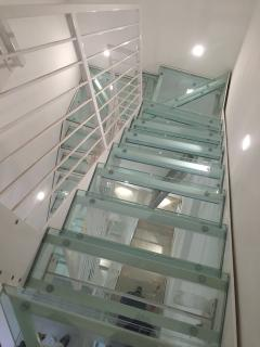 The steel and glass stairs of Duomo Inn