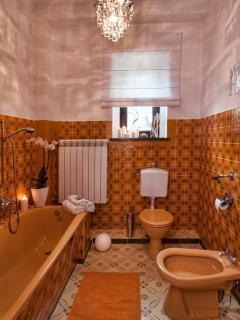 Downstairs Bathroom comprising of a bath tub, toilet and bidet