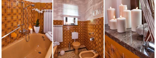Glamour style with original tiles and silver accessories