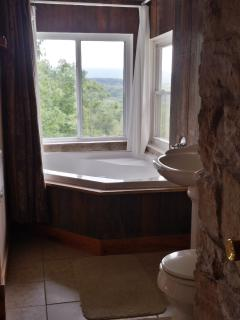 full bath with shower head, relax in the large Jacuzzi tub while enjoying gorgeous views