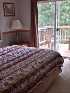 bedroom with queen bed, outside deck with gorgeous views