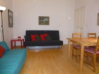 Two double bed sofas and table in living room