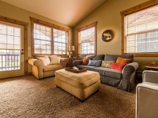 Living room has plenty of comfortable seating available for everyone.