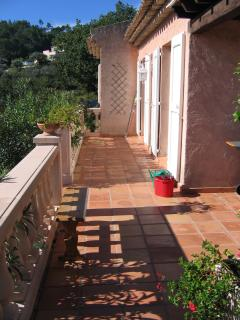 The terrace is a sun trap for most of the day with views over the pool and garden