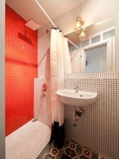 tastfull tiles and rain shower bathroom