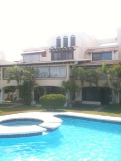 Home in a gated community with gardens and swimmingpools,