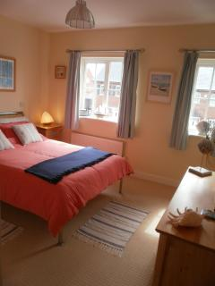Master bedroom with double bed, fitted wardrobes, dressing table/stool, 19' flat-screen TV/DVD