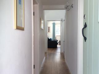 Hallway, wooden floors throughout a spacious property with lots of natural light.
