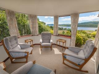 Cosy sunroom with views to Loch Awe and the hills above. Warm at all times of year