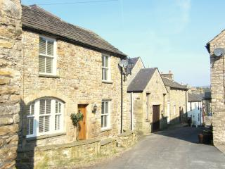 The cottage is nestled between churches and centuries old inns