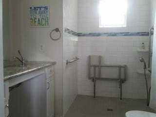 2 FULL ACCESS BATHROOMS WITH WALK IN/SIT DOWN SHOWERS