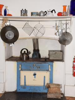 Kitchen showing original stove