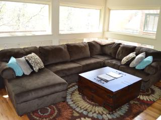 Large, comfortable microfiber couch, windows letting in lots of natural light