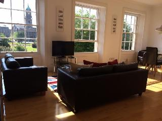 Open plan living room with views across the beautiful square