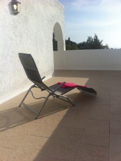 Upstairs balcony private sunbathing..