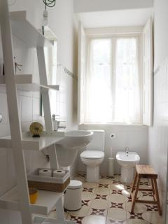 Bathroom with window and natural light. New sanitary ware designed by Álvaro Siza.
