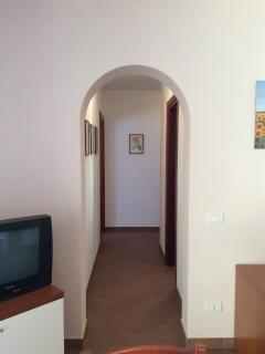 Living room with TV and corridor