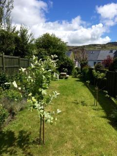 Spacious sunny garden with path leading to Nefyn bay