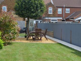 Massive rear garden equipped with BBQ, table & chairs & loungers
