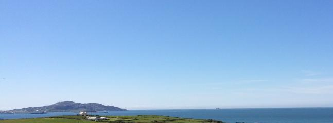 View onto Holyhead bay from lane down to Ysgubor Hen and Hen Llety