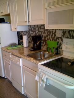 Kitchen w/ smoothtop stove and dishwasher