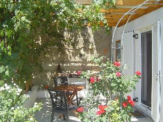 Enjoy breakfast under the shade of the grapevine, or an evening BBQ in your own private garden.