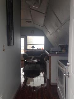 Entryway. Full stove and kitchen on right, miniature