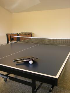 Ping-pong table in the game room is waiting for you and your family.
