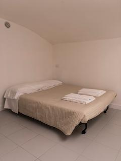 Double bedroom with a double bed and second bathroom. This room is at -1 floor.