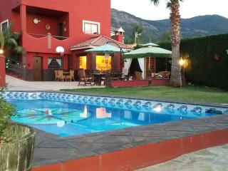 Apartment with private pool, garden and BBQ area.