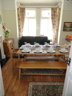The dining table and bay with comfortable sofa.