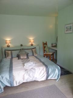 The Granary Bedroom with super king size bed french windows to terrace with river view
