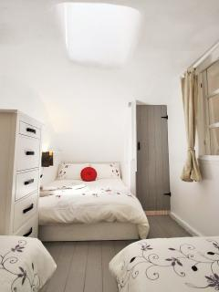 Bedroom 4, private, enclosed mezzanine with 2 single beds and 1 double
