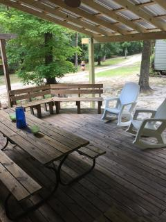Covered deck with picnic table, grill and fan