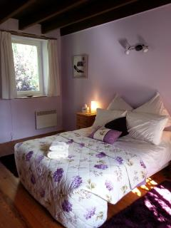 Rear view of The Lavender Bedroom dual aspect window overlooking the willow garden