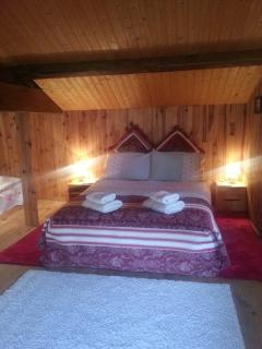 The comfortable double bed in the Attic Family Room