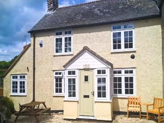 ST MARGARET'S COTTAGE, semi-detached, woodburner-style gas fire, private patio, Tatworth