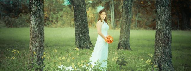 Bridal photo taken in the longhorn pasture.